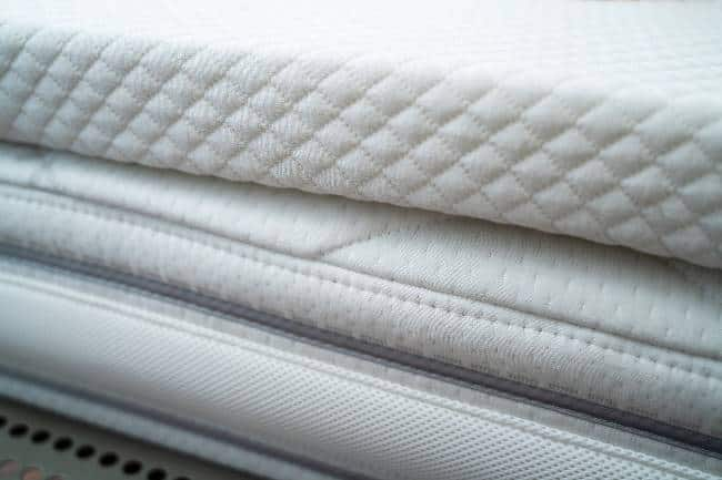 Mattress toppers for pain relief